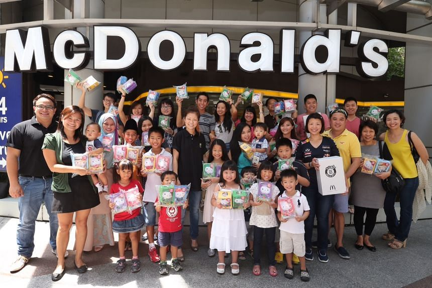 17 of The Straits Times readers become the first in Singapore to get their hands on the limited edition SG50 Hello Kitty sets from McDonald's at McDonald's Springleaf Tower along Anson Road on July 18, 2015.