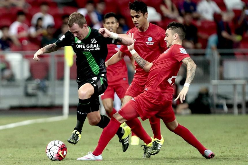 Stoke City's Glenn Whelan (left) in action against Singapore Selection's Shahdan Sulaiman (2nd right) and Nicholas Velez (right).
