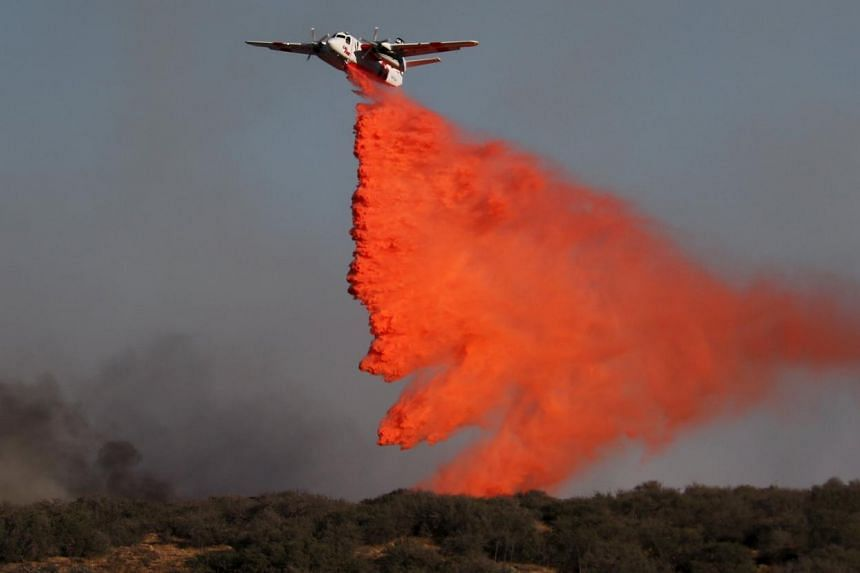 Air tankers make drops at the North Fire near the Phelan, California on July 17, 2015.