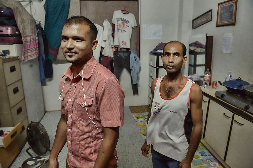 (Left) The outside of the bin centre at Block 731, Yishun Street 72. (Below) Bangladeshi cleaners in the bin centre at Block 768, Yishun Avenue 3, are equipped to cook, have erected lines of laundry, installed several cabinets for their belongings, a