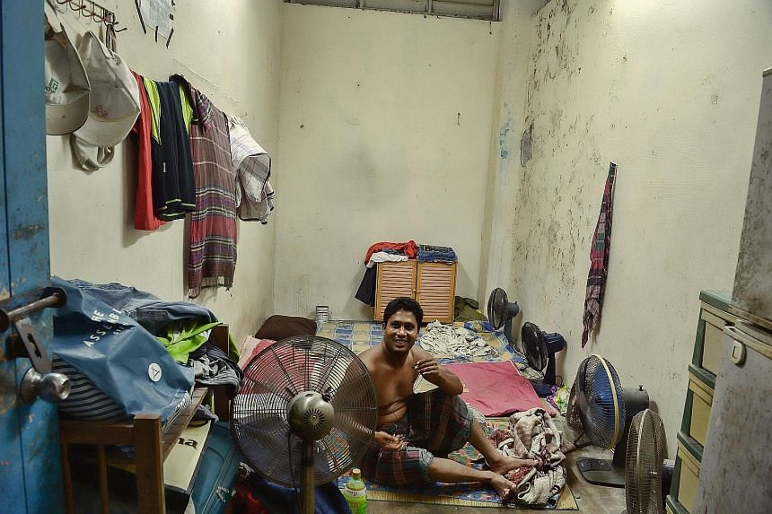 """A cleaner resting in the bin centre at Block 125, Pending Road in Bukit Panjang. Like other cleaners found occupying bin centres at some HDB estates, he denies living in one. He said that it is a convenient resting place. """"In the afternoons, when we"""