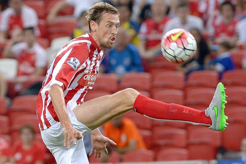 Stoke City striker Peter Crouch in action against Everton at a Barclays Asia Trophy match at the National Stadium on Wednesday. The 34-year-old Englishman spent time in Singapore as a young boy, and says he has been touched by the warmth of fans here