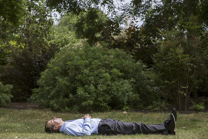 People relax at various parts of St James' Park (above and above left) in central London, Britain.