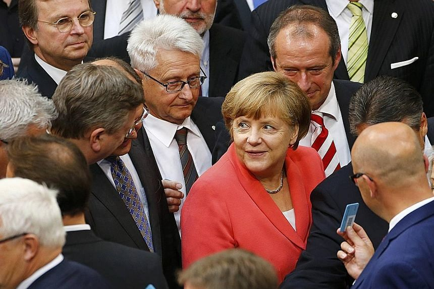 German Chancellor Angela Merkel at yesterday's voting session to decide whether to negotiate a third bailout for Greece. Germany is the euro zone country that has contributed the most to Greece's previous bailouts.