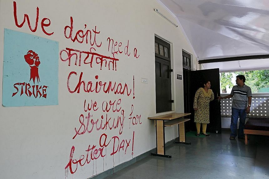 Graffiti in an office at the Film and Television Institute of India reflects the sentiments of the students. Some people fear that the choice of BJP member Gajendra Chauhan as chairman of the institute signals a push by Prime Minister Narendra Modi's
