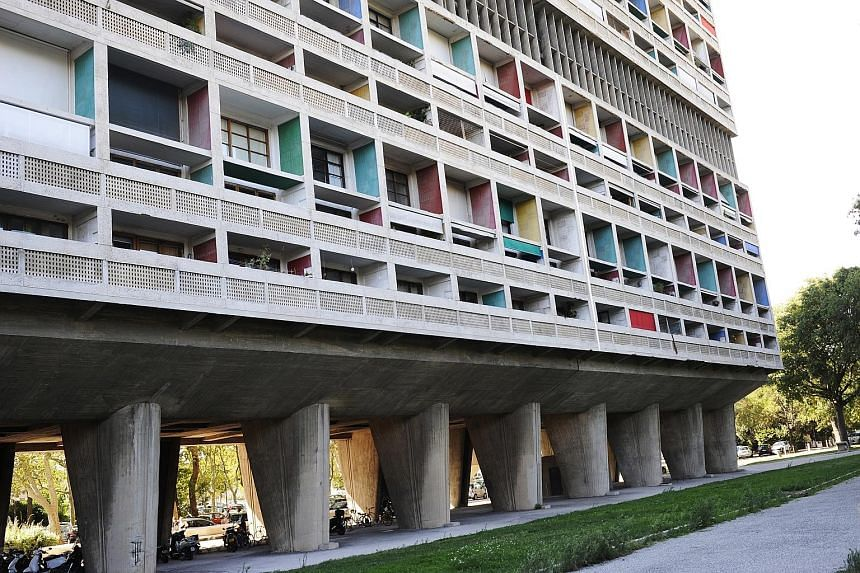 The famous 1952 vertical village, Cite Radieuse (left), in Marseille, France, is by Le Corbusier (above).