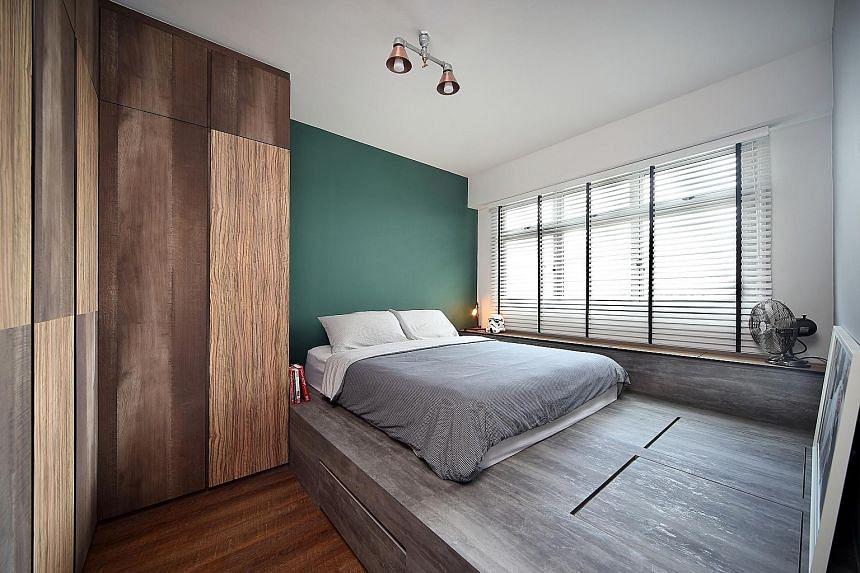 Mr Ray Tay and his wife Janet Khoo (both above, with their son Xander) bought a dark brown leather Chesterfield sofa and designed their industrial-classic retro home (left) around it. A half-height cabinet near the window in the master bedroom (left)