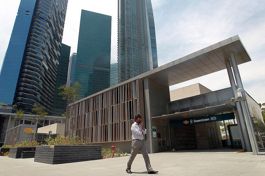 """The Cushman & Wakefield report says that there have been recent moves by banks and tech companies to relocate from core CBD areas such as the Marina Bay Financial Centre (above, background) to business parks """"where rents are at least 30 per cent lowe"""