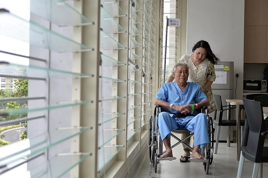 Mr Lo Chun Meng, 84, with his daughter Eileen Koh in Changi General Hospital. He opted for C class because it was the cheapest, he said.