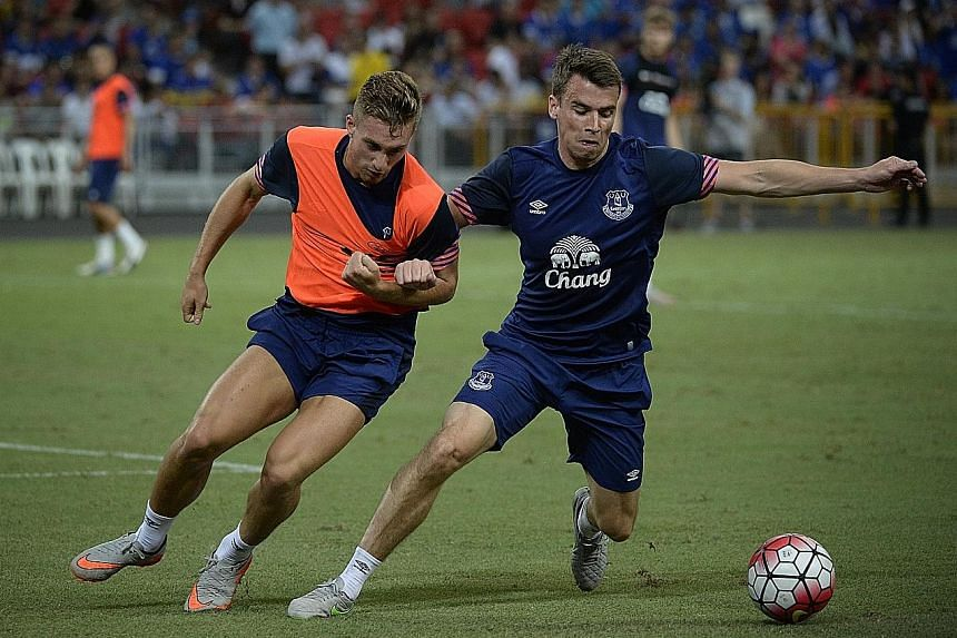"Everton's Gerard Deulofeu (left) and Seamus Coleman training at the National Stadium on Tuesday. Phil Jagielka said the Toffees, who face Arsenal in the Barclays Asia Trophy final today, ""have more options now""."