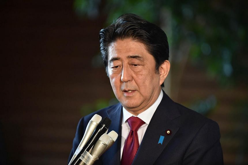 Japan's Prime Minister Shinzo Abe speaking at a press conference after a meeting regarding the 2020 Olympic stadium.