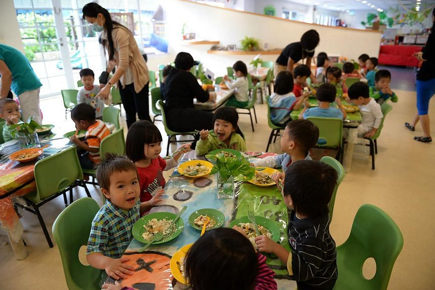 Children having a meal at a childcare centre in Ngee Ann Polytechnic.