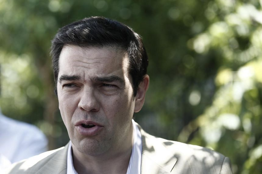 Greek PM Alexis Tsipras has axed ministers who had rebelled over draconian bailout terms set by the EU.