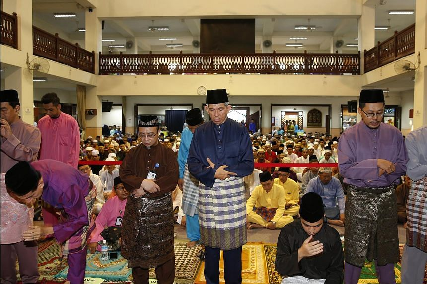 Minister-in-charge of Muslim Affairs Yaacob Ibrahim (centre) praying at Alkaff Kampung Melayu Mosque.