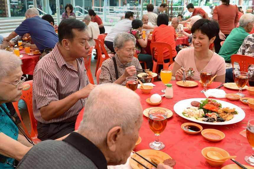 Senior Minister of State, Ministry for Law and Ministry of Education Indranee Rajah (right) having a reunion lunch with 140 elderly in the Tanglin-Cairnhill Constituency on 13 February 2013.