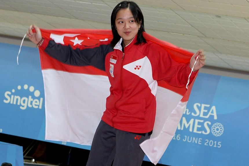 Jazreel Tan at a victory ceremony at the 28th SEA Games Bowling Women's Master Step-Ladder final at Orchid Country Club on June 14, 2015.
