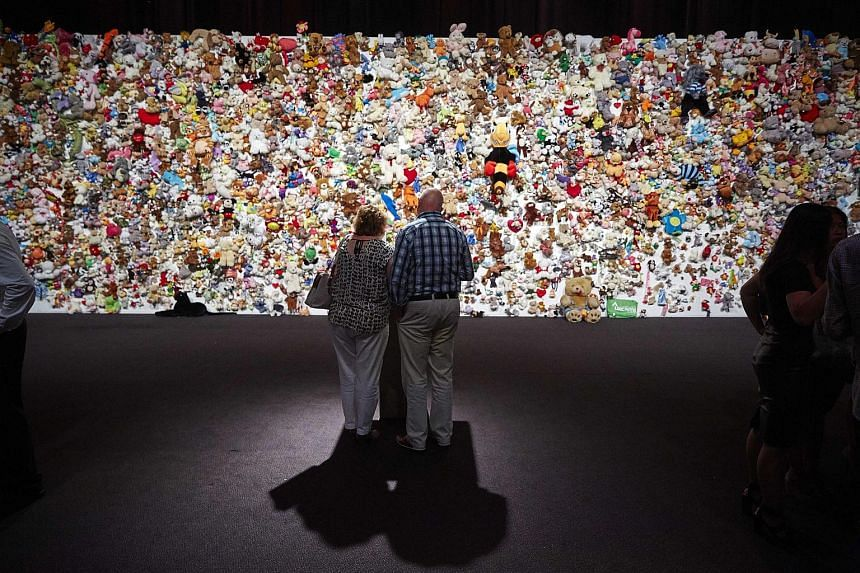 """A """"hedge of compassion"""", made of thousands of stuffed animals in memory of the MH17 victims, in Nieuwegein, Netherlands."""