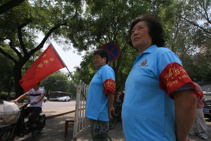 Residents of Chaoyang district are becoming intelligence gathering heroes in the fight against crime. But some residents have complained about being under constant watch and about the nosy behaviour of some of the elderly volunteers.