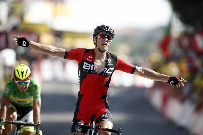 Avermaet crosses the finish line to win the 13th stage of the Tour de France.