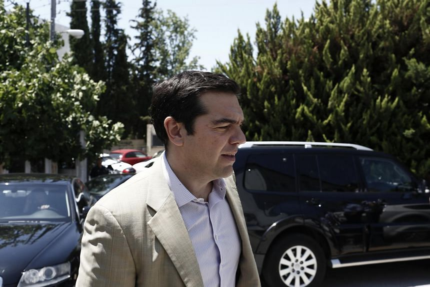 Greek PM Alexis Tsipras arrives for a briefing about wildfires in Athens.