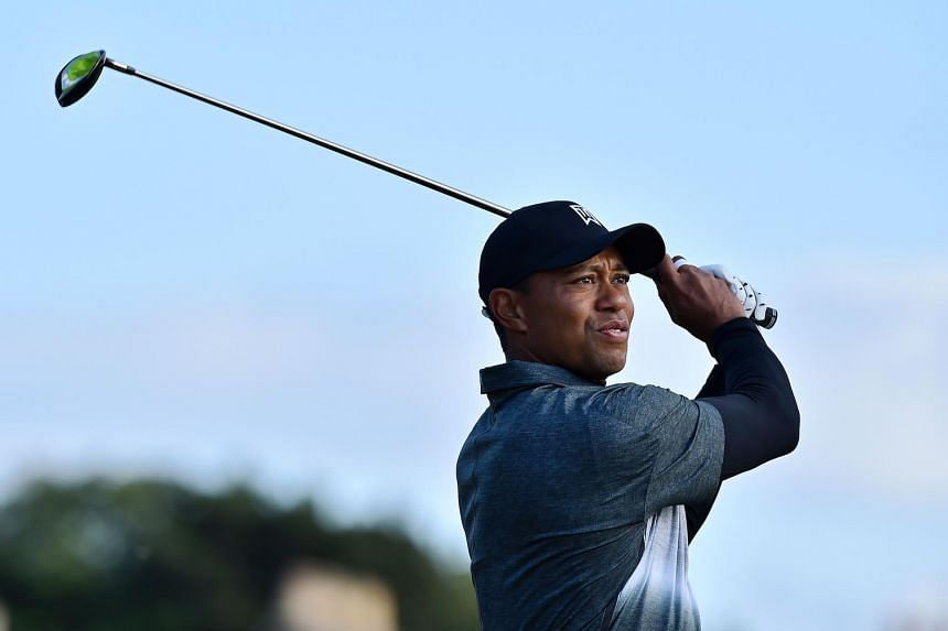 Woods watches his shot from the second tee on day two of the British Open.