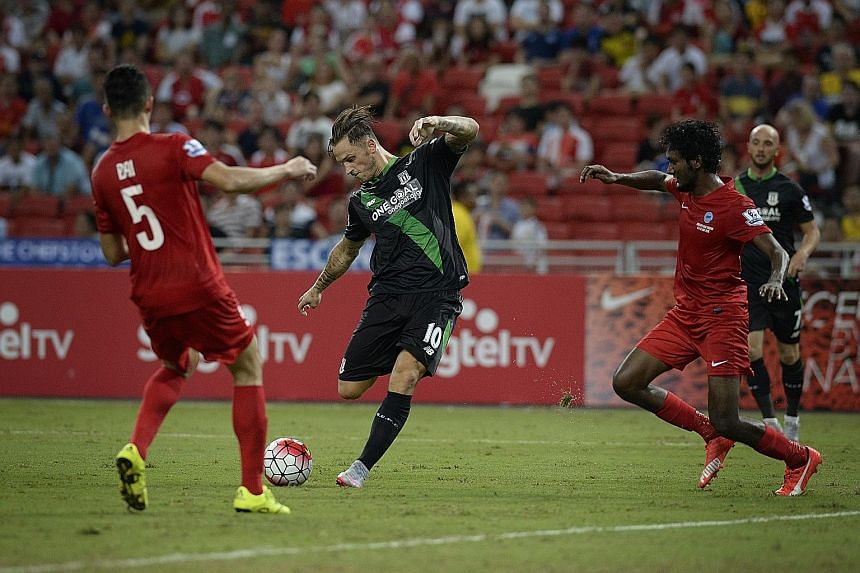 Clockwise from top: Stoke City midfielder Marko Arnautovic (centre) squeezing his shot between Singapore defenders Baihakki Khaizan and Madhu Mohana to score his team's second goal. Singapore striker Khairul Amri receiving the close attention of Geof