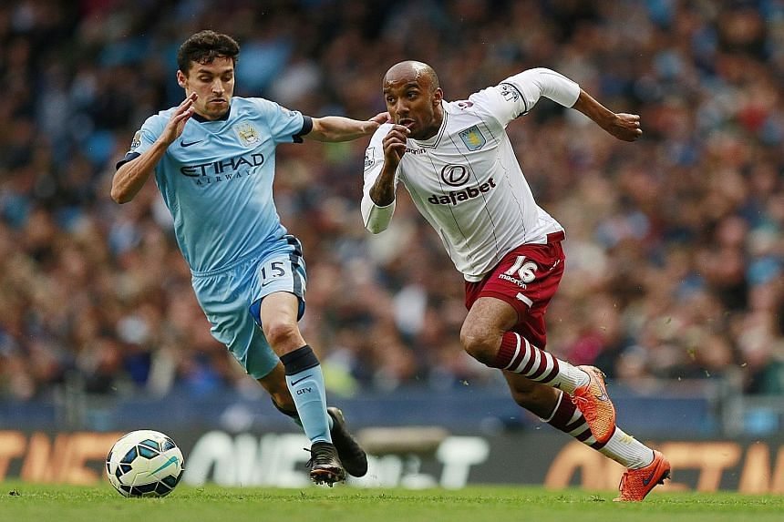 Fabian Delph (right) in action against Manchester City's Jesus Navas. The pair are now team-mates after a topsy-turvy series of events.