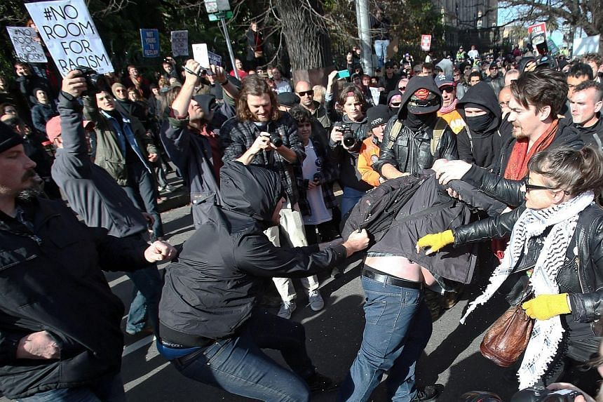 "Protesters in a scuffle outside Parliament House in Melbourne yesterday, as anti-racism activists attempted to keep the nationalists from holding their ""Reclaim Australia"" rally. About 450 police officers were on hand, and used pepper spray as they s"