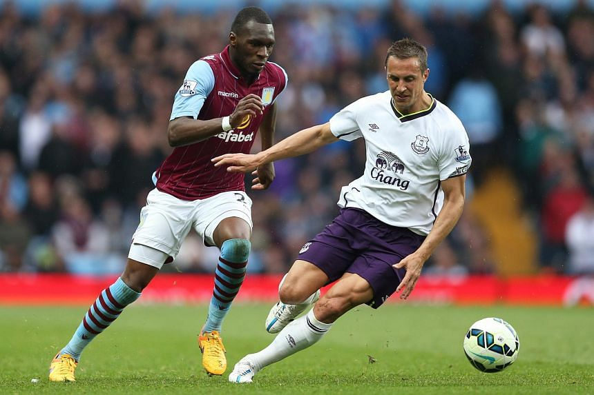 Aston Villa's Christian Benteke (left) challenging Everton's Phil Jagielka for the ball during their Premier League match at Villa Park on May 2, 2015.
