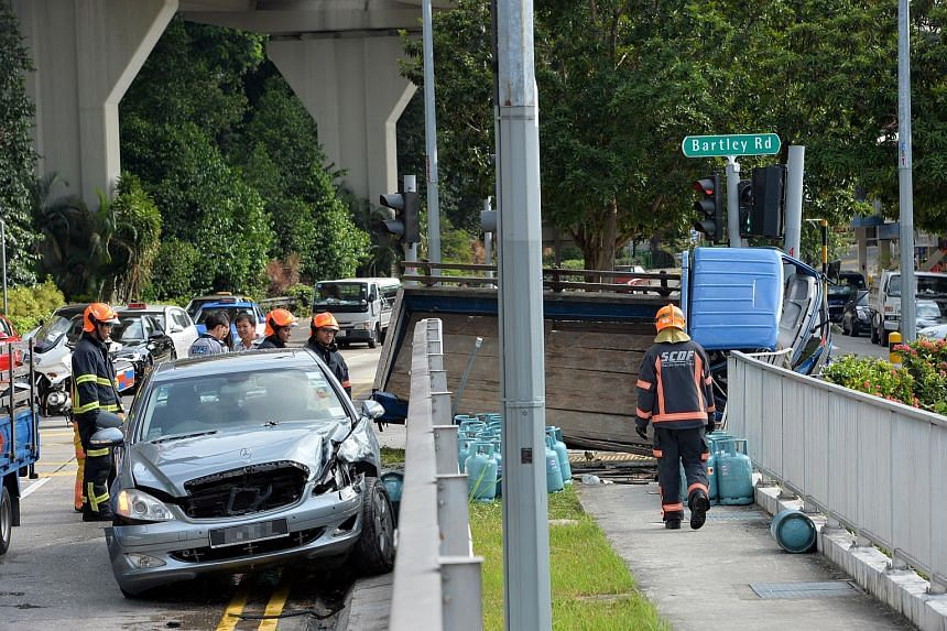 Gas canisters were scattered on the road after a lorry crashed into a car at the junction between Upper Serangoon Road and Bartley Road.