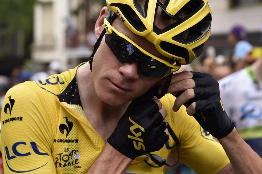 Froome adjusts his communication equipment prior to the start of the 178,5km 14th stage.