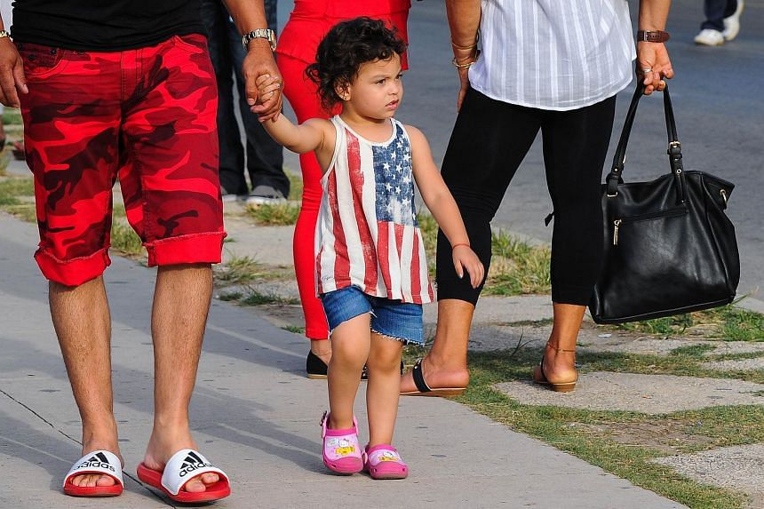 A girl wearing a top with a US flag design is seen in the Cuban capital of Havana.