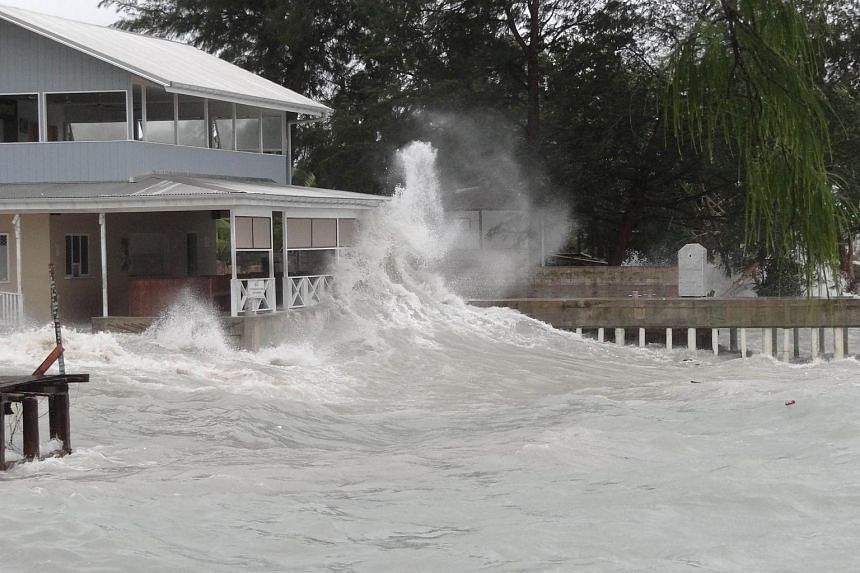 A seaside restaurant Majuro atoll getting swamped by high waves, losing its dock and sustaining damage as a tropical depression built up power on its way through the Marshall Islands on July 3, 2015.
