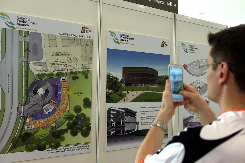 A man taking pictures of details of the new hawker centre at Paasir Ris.