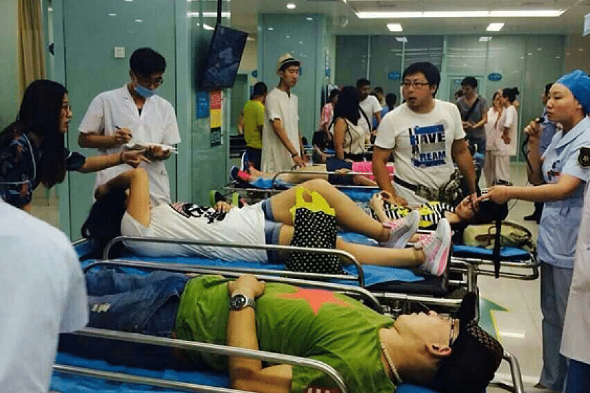 Injured passengers lie on stretchers on their way to hospital