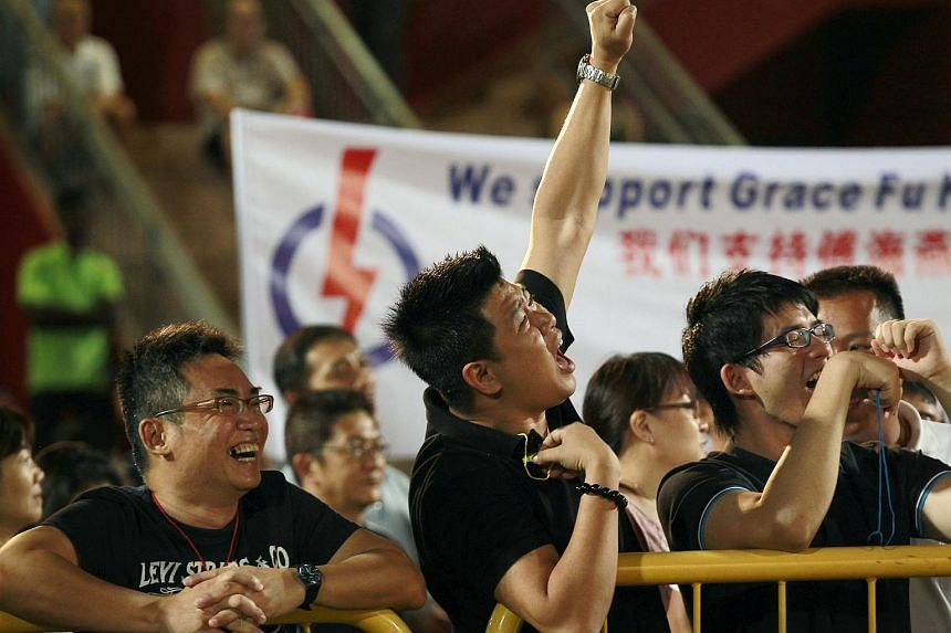 Supporters cheering at the People's Action Party (PAP) rally for Yuhua SMC electorial division at Jurong East Stadium on  May 2, 2011.
