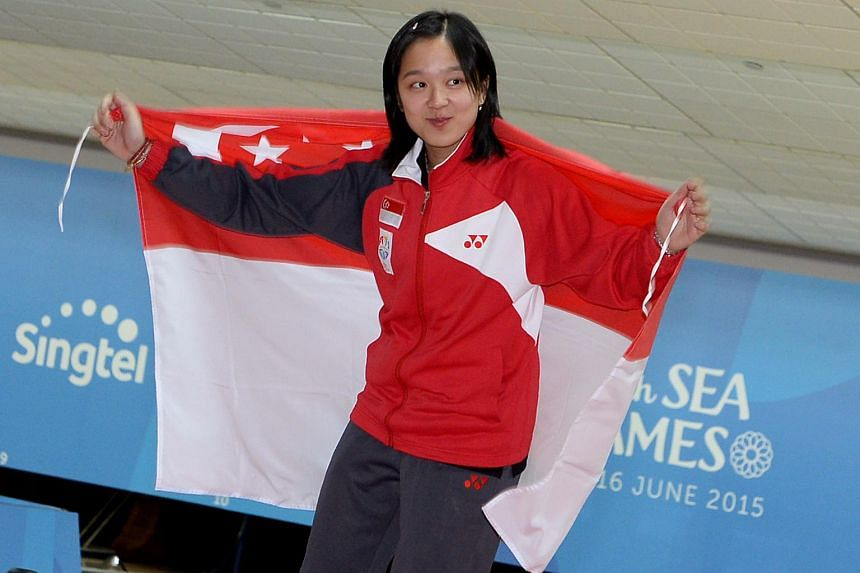 Jazreel Tan at the victory ceremony of the Women's Master Step-Ladder Bowling final during the 28th SEA Games.