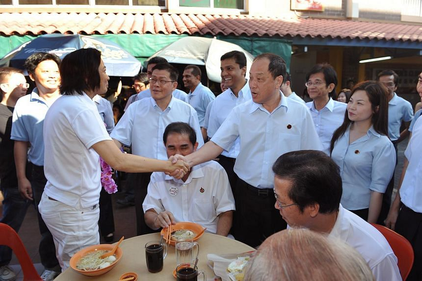 Workers' Party chief Low Thia Khiang shaking hands with Ms Lee Bee Wah, one of the People's Action Party's (PAP) candidates for Nee Soon GRC, during a walkabout in Yishun Central on May 3, 2011.