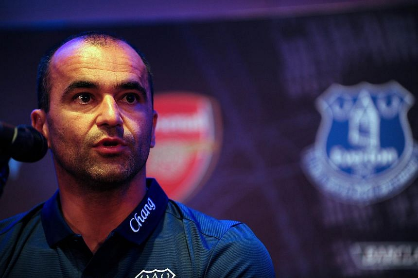 Premier League football club Everton's Spanish manager Roberto Martinez speaks during a press conference for the Barclays Asia Trophy 2015 (BAT) in Singapore on July 14, 2015.