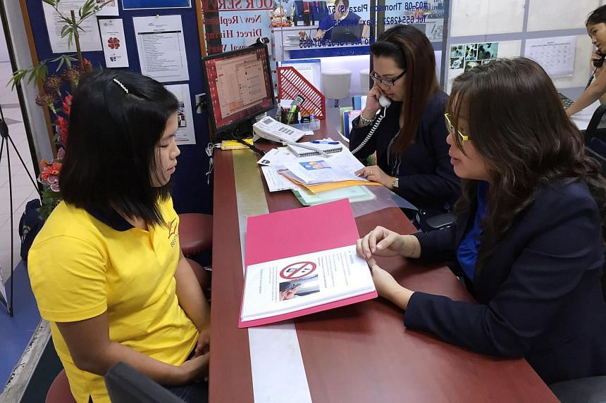 New maids are given a free SIM card and some tips on mobile phone usage at Best Home Employment Agency.