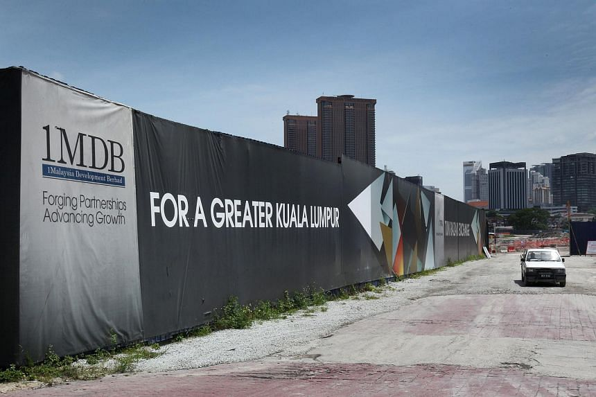Signage for 1MDB is displayed at the site of the Tun Razak Exchange (TRX) project in Kuala Lumpur, Malaysia.
