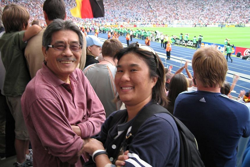 Former Singapore star Quah Kim Swee and daughter Bee Jin at the Germany-Argentina quarter-final in Berlin.