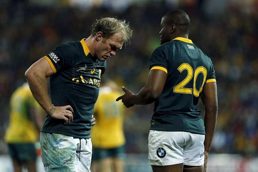South Africa's Springboks flanker Schalk Burger (left) and Teboho Mohoje react in their Rugby Championship game loss to Australia's Wallabies in Brisbane on July 18, 2015.