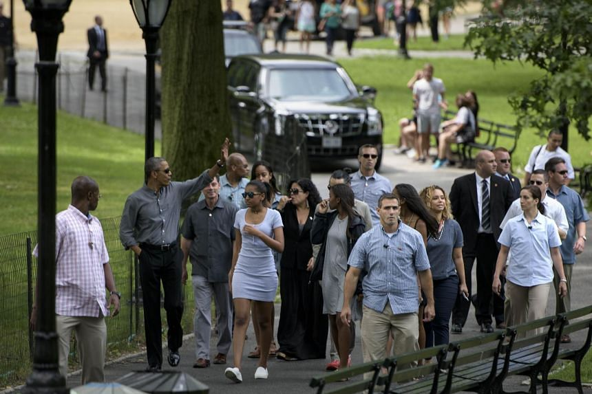 Obama walks in Central Park with his daughters and security detail.