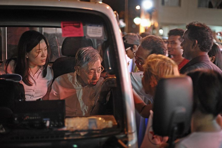 Mr Chiam See Tong, with his daughter Camilla, being greeted by residents as the Singapore People's Party (SPP) team returned to Potong Pasir.