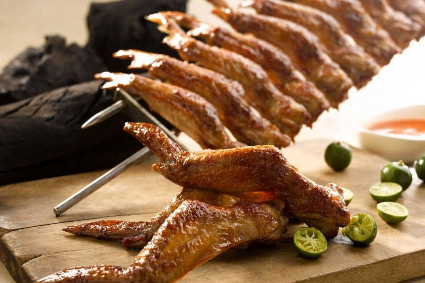Snack on Huat Huat BBQ's chicken wings at Palette Restaurant & Bar.