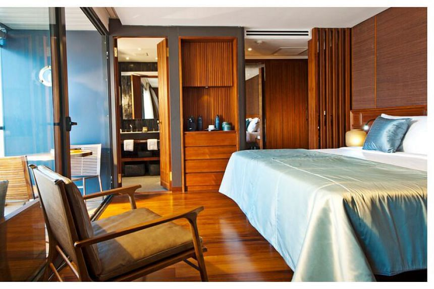 A California king-suite (above) on the Aqua Mekong.