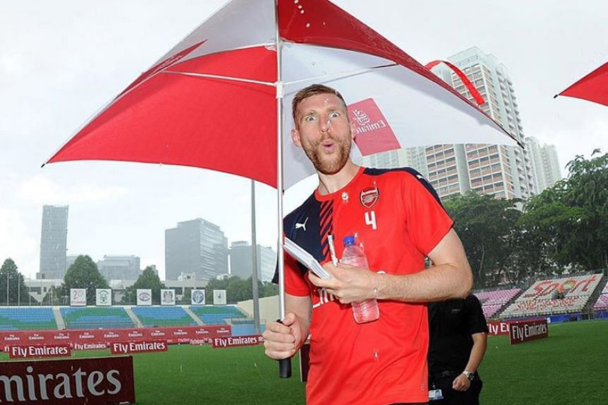 Towering defender Per Mertesacker making a funny face at the camera during the Emirates football clinic at the Jalan Besar Stadium.