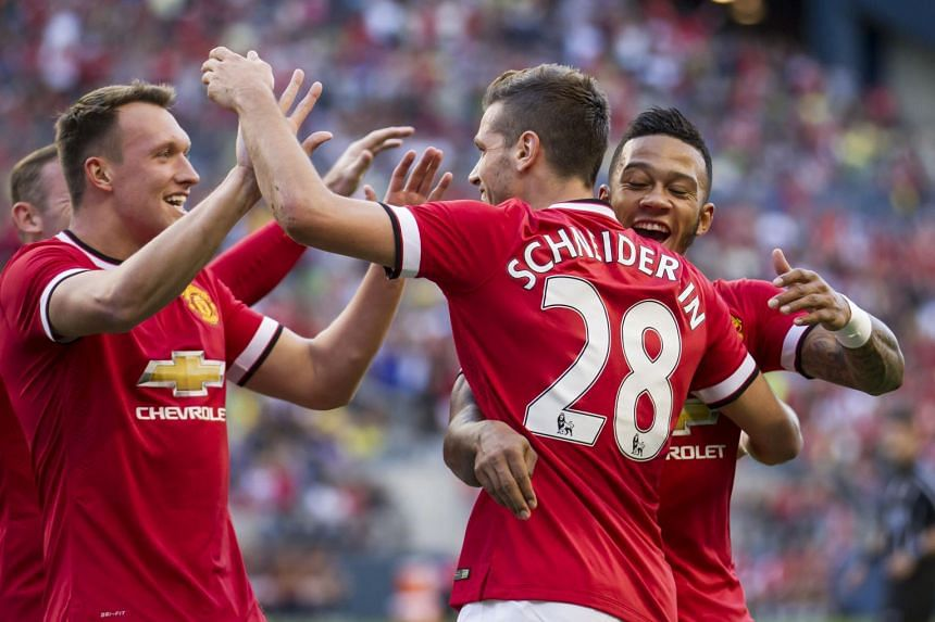 Manchester United's Morgan Schneiderlin (centre) is congratulated by team-mates Memphis Depay (right) and Phil Jones after scoring against Mexico City-based Club America in their International Champions Cup match in Seattle on Friday.