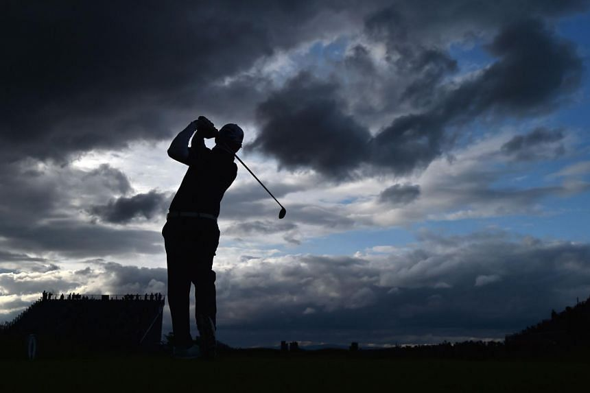 South African Louis Oosthuizen teeing off from the par-four third hole on Friday as storm clouds gathered. Yesterday, play was due to resume at 4pm local time after being halted since early morning and the R&A planned to have three-player groupings i